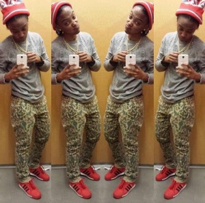 Charice paired her red and black beanie with matching Adidas Samoas, camo pants, and a gray top